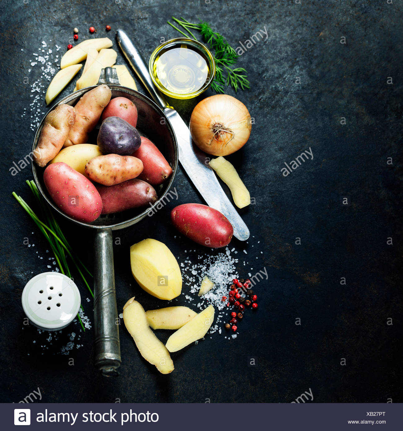 Potato preparation. Fresh organic vegetables. Food background. Healthy food from garden - Stock Image