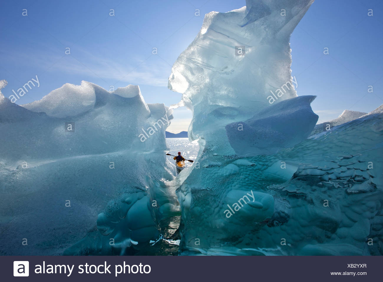 Sea Kayaker views large icebergs in Stephens Passage, Tracy Arm-Fords Terror Wilderness, Inside Passage, Alaska - Stock Image