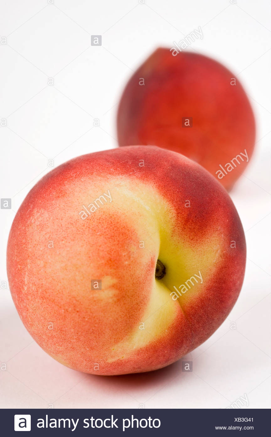 Cutout of a Peach on white background - Stock Image