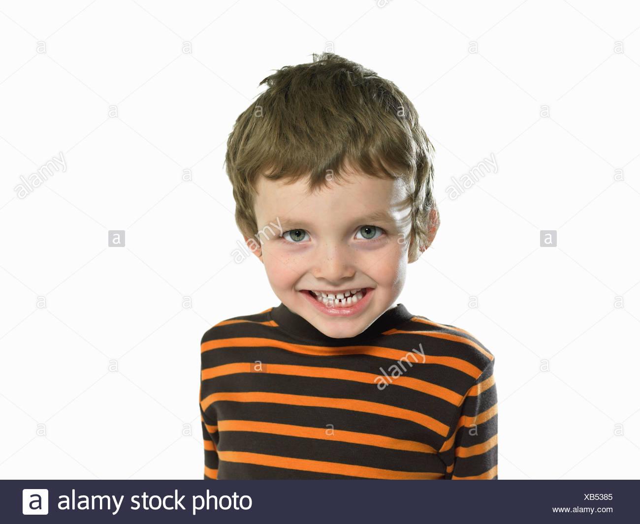 Cheeky looking boy - Stock Image