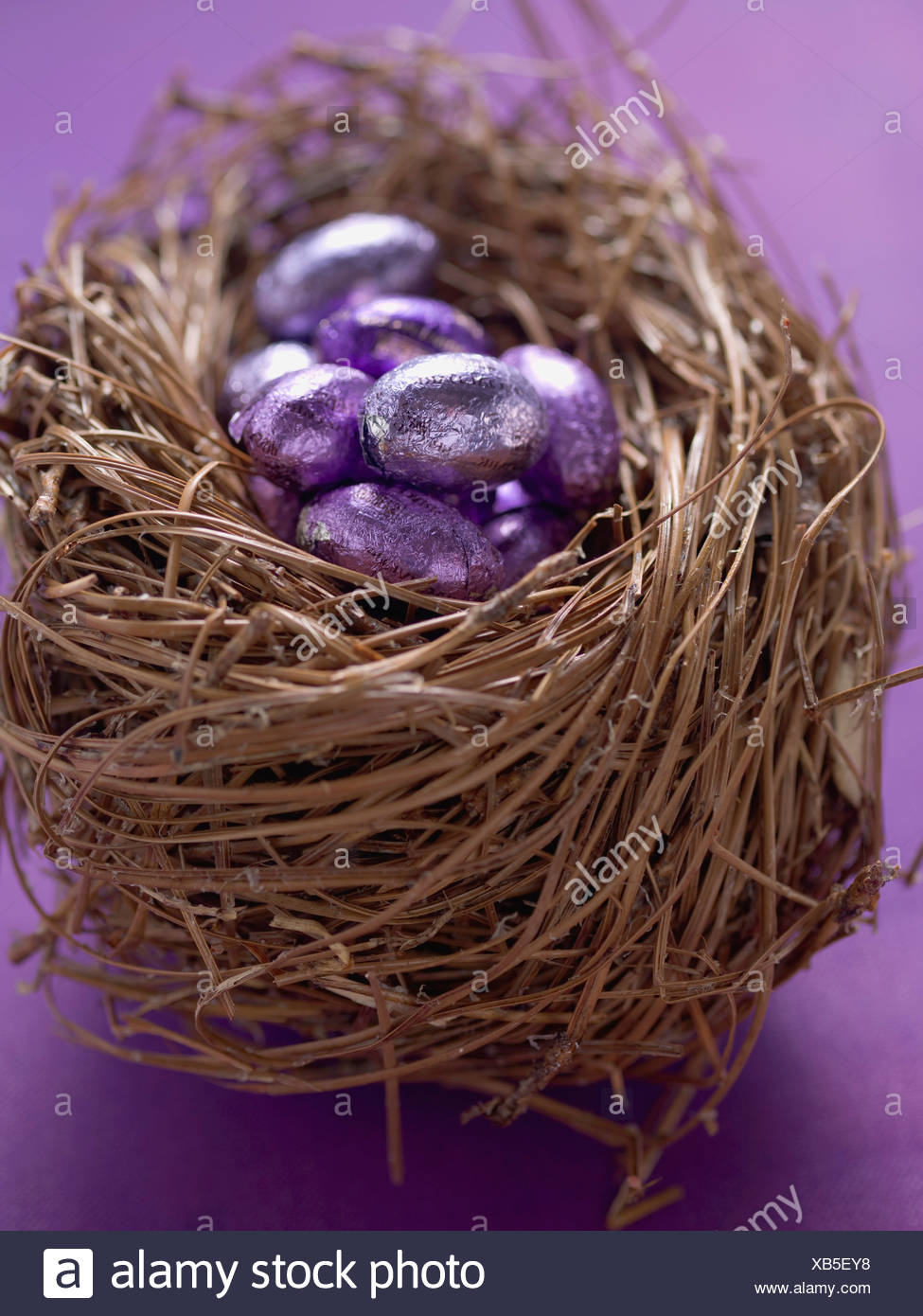 Chocolate Easter Eggs In Purple Foil An Nest