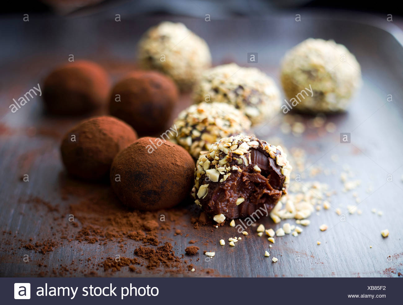 Different flavored chocolate truffles - Stock Image