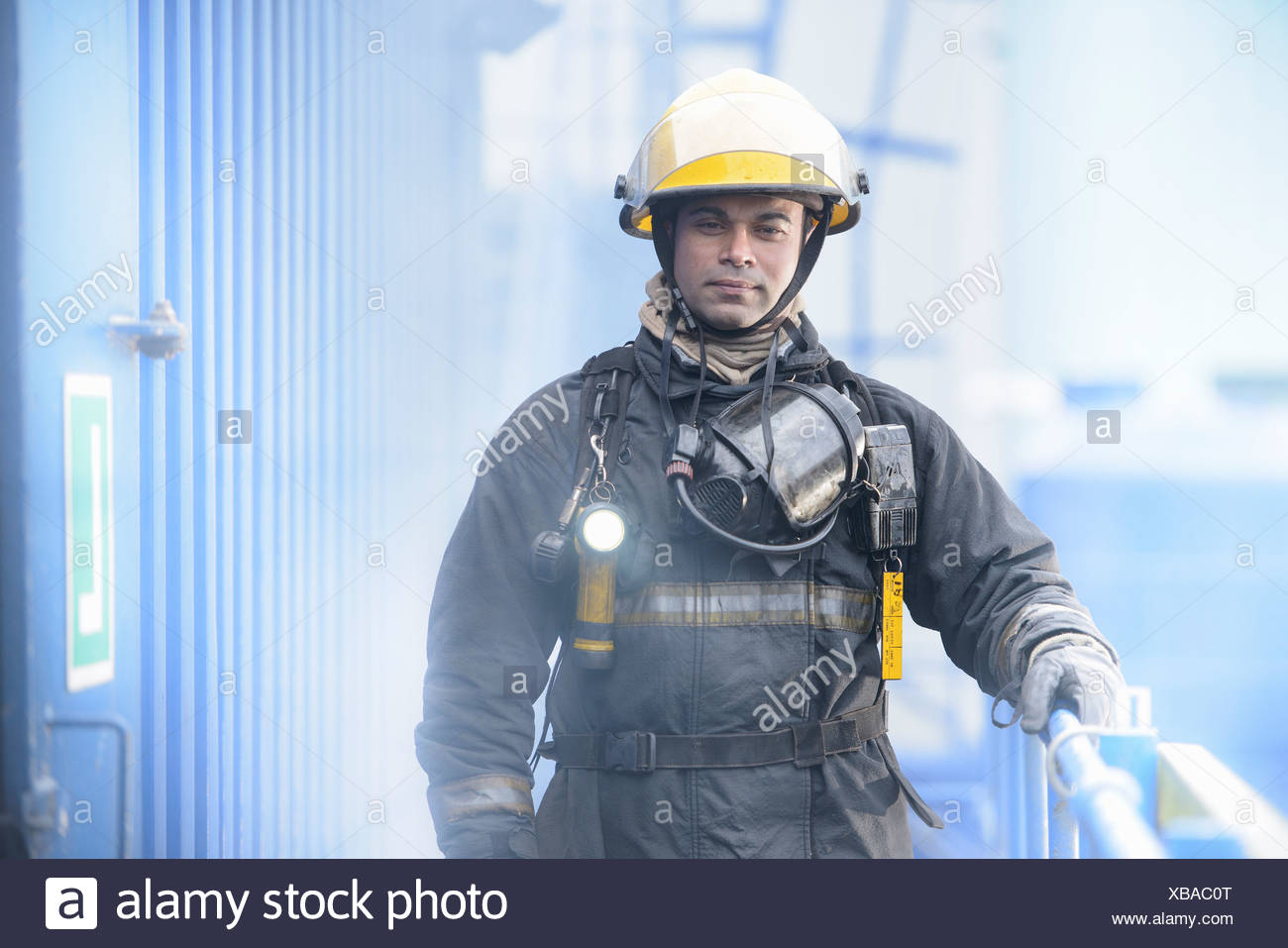 Firefighter standing on platform - Stock Image
