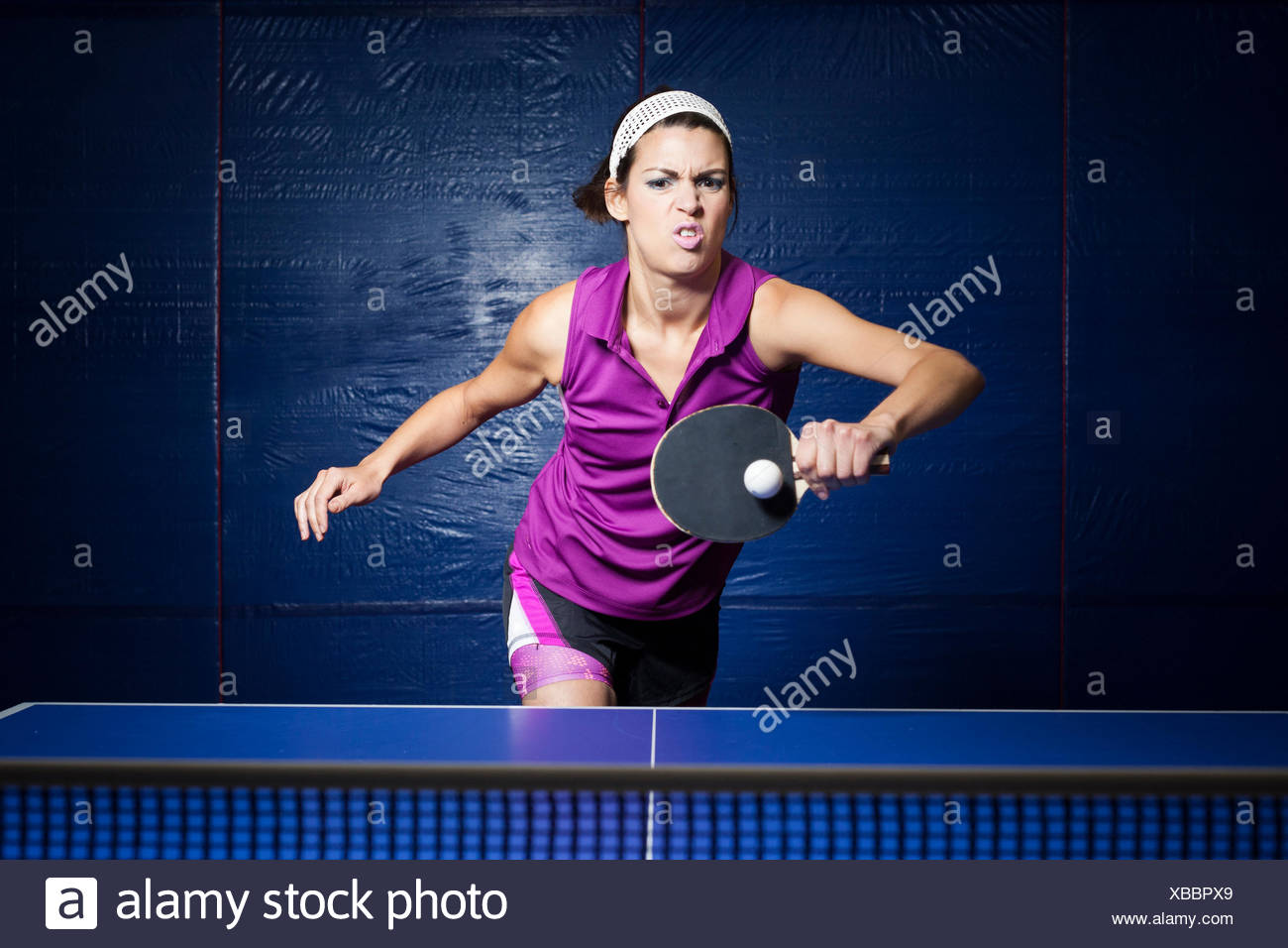 Table tennis player training - Stock Image