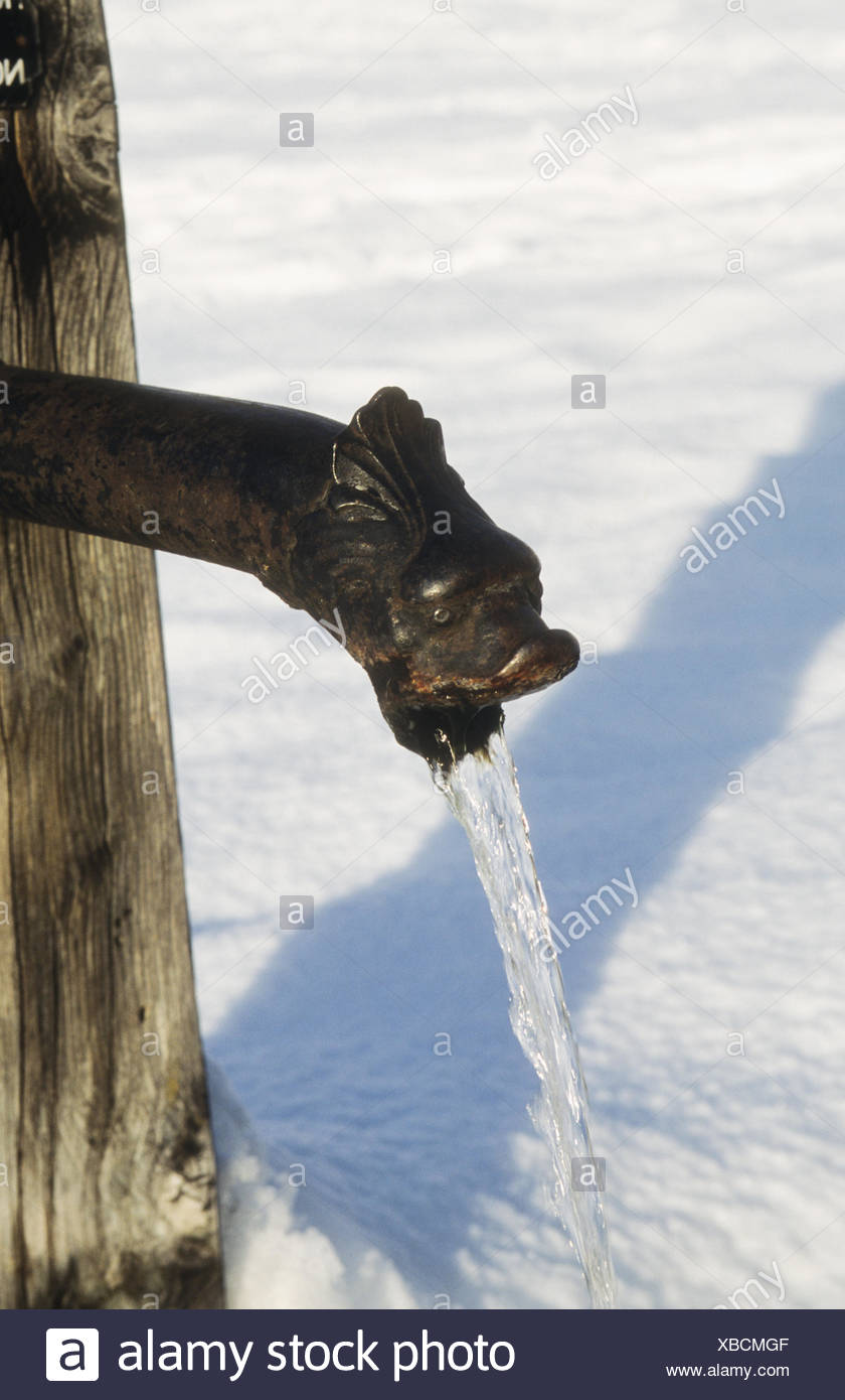 old French water spigot in the snow Stock Photo: 282406671 - Alamy