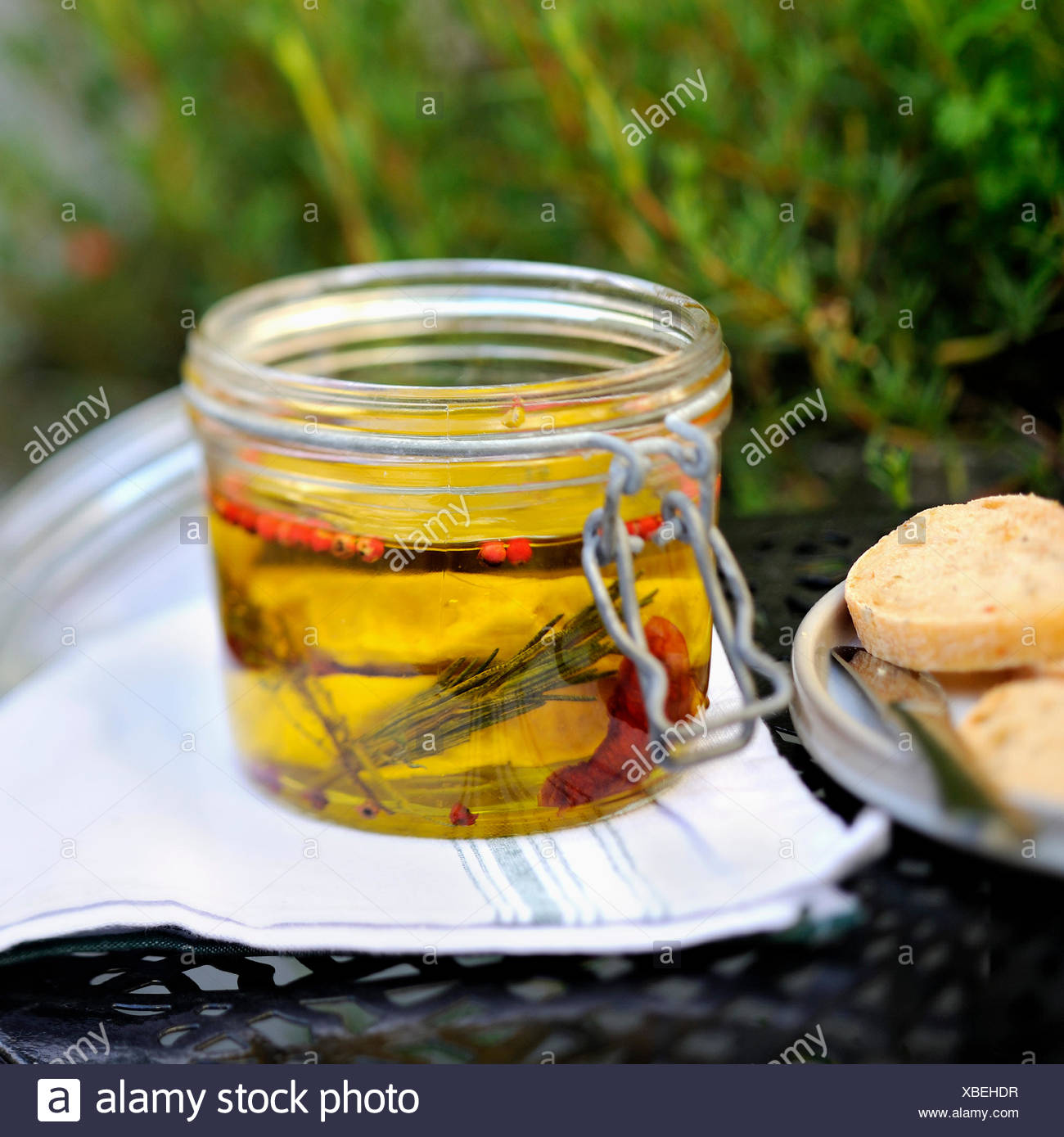 Jar of goat's cheese marinating in olive oil - Stock Image