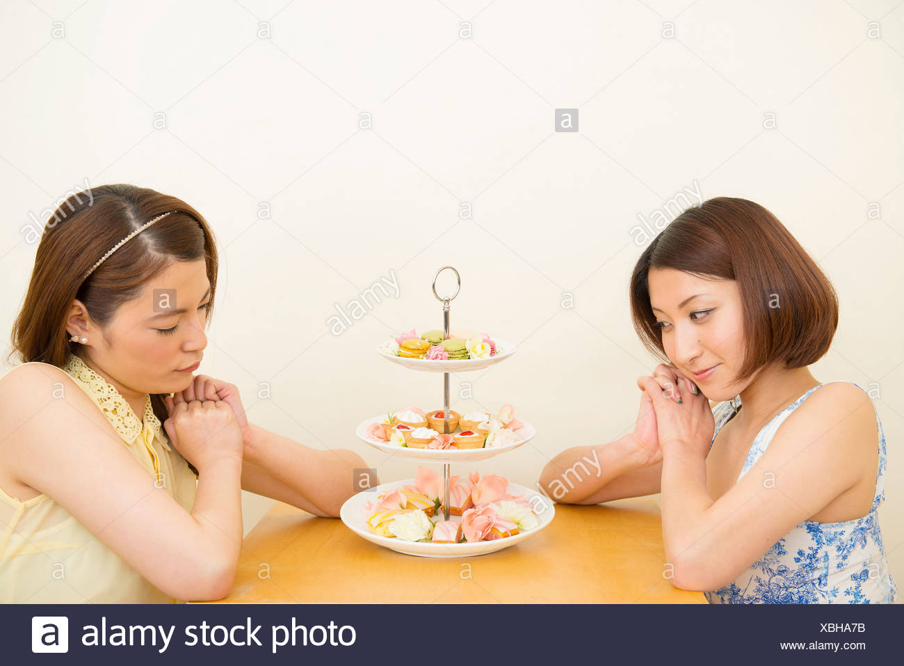 Two women looking at assortment of confectioneries - Stock Image