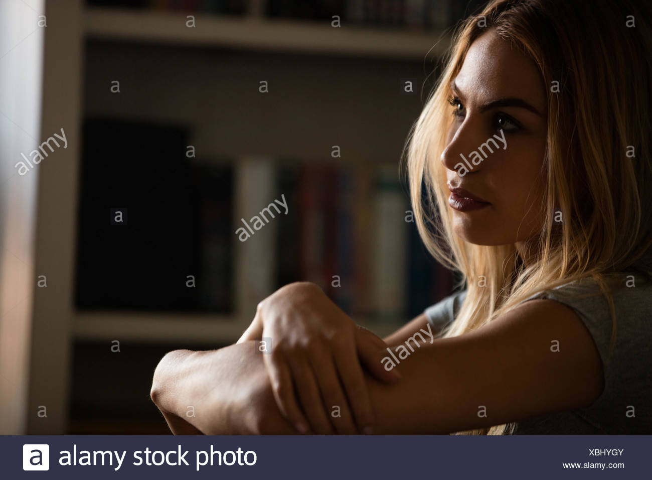 Pretty thoughtful woman looking away - Stock Image