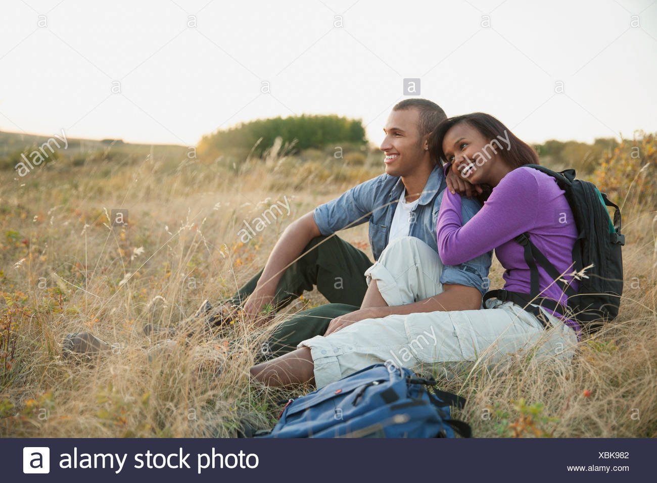 Couple relaxing after their outdoor hike. - Stock Image