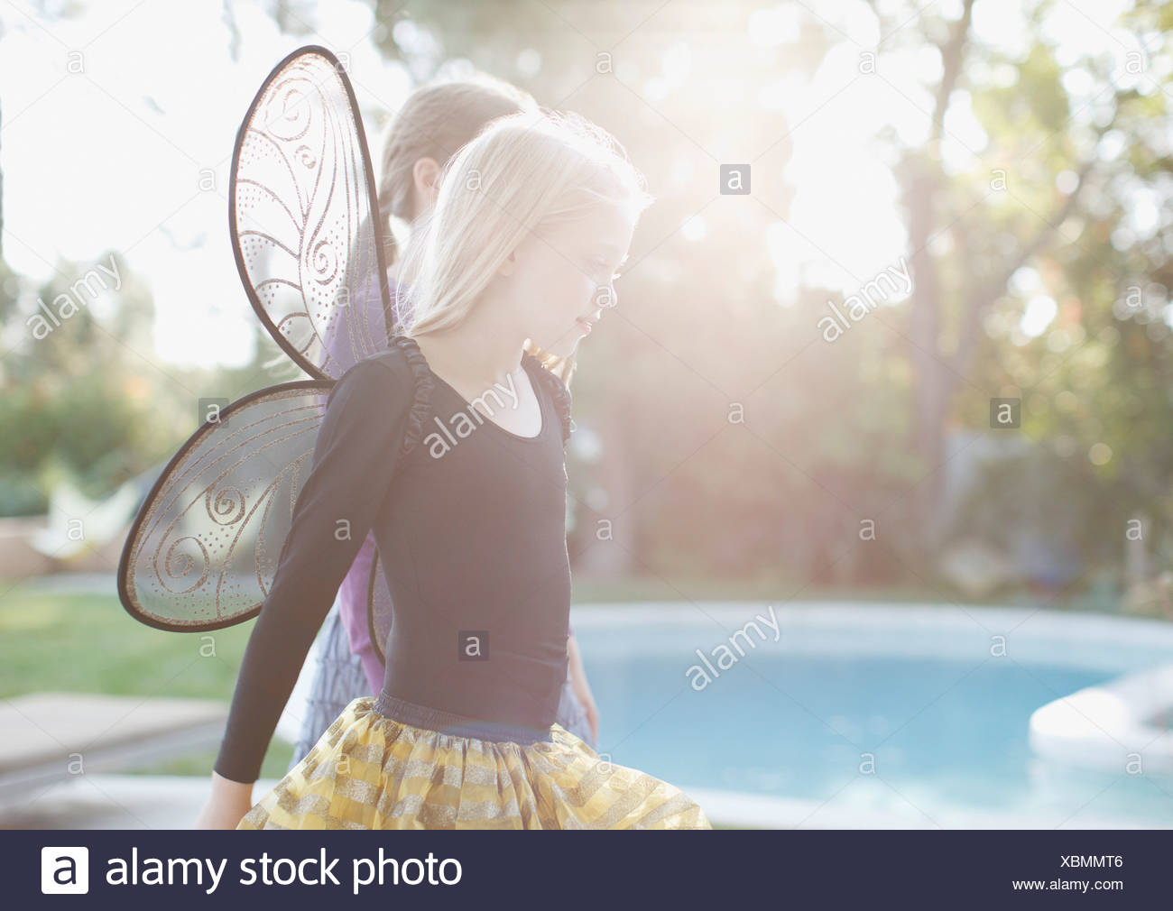 8-9 years,back lit,california,casual clothing,caucasian,childhood,color image,costume,day,domestic life,elementary - Stock Image