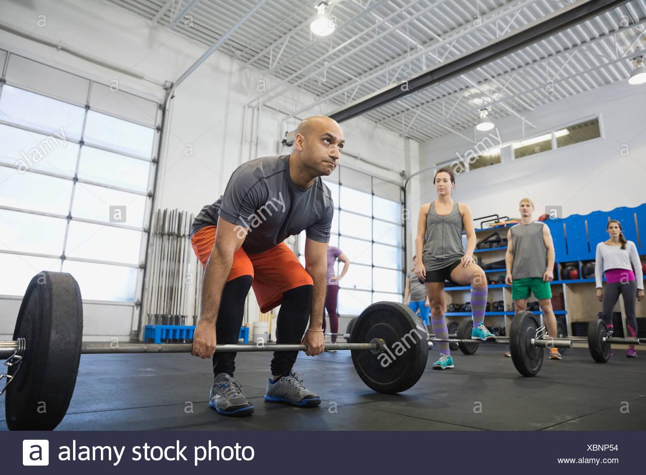 Instructor demonstrating proper deadlift technique - Stock Image