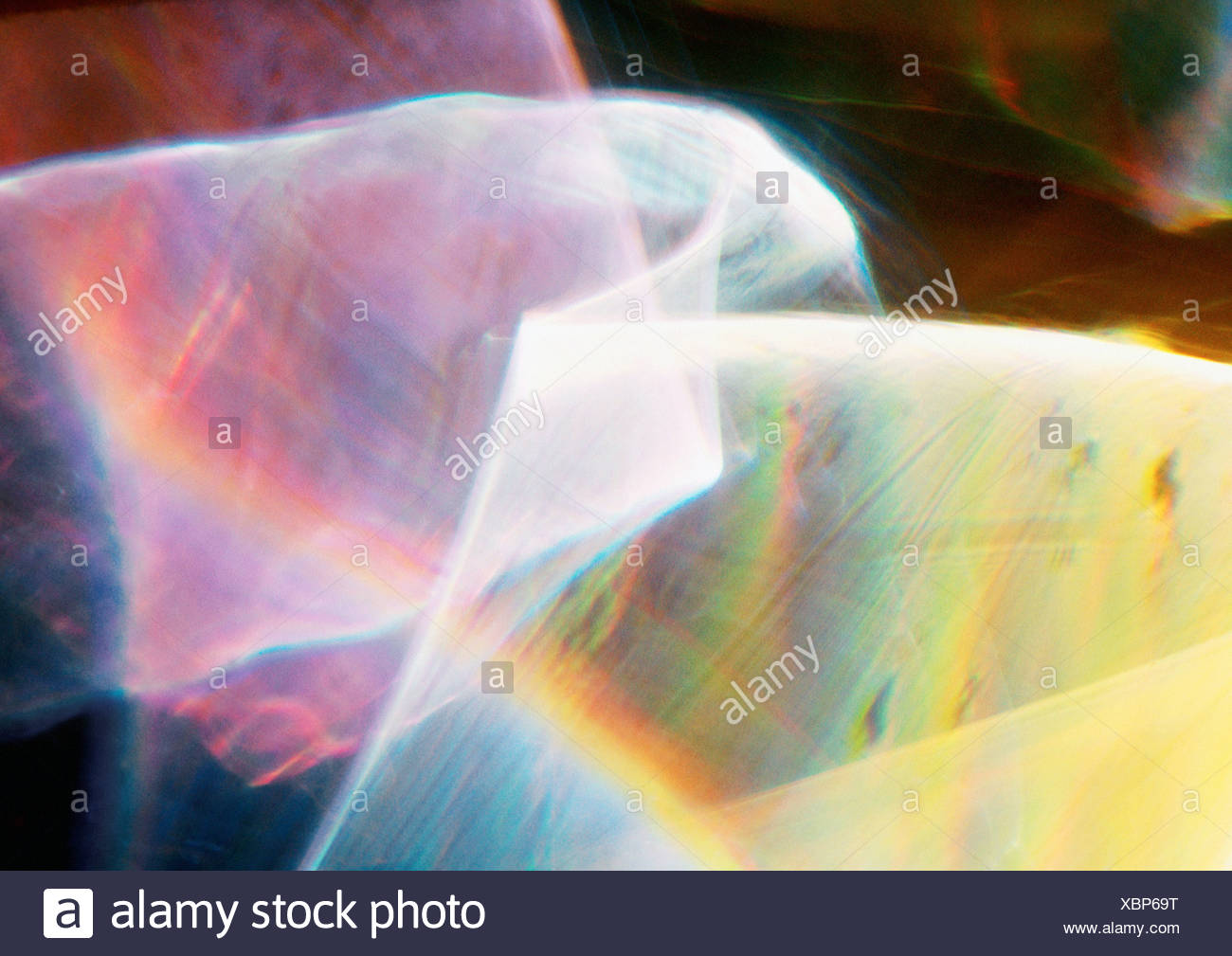 Light effect, pinks and yellows with rainbow effect - Stock Image