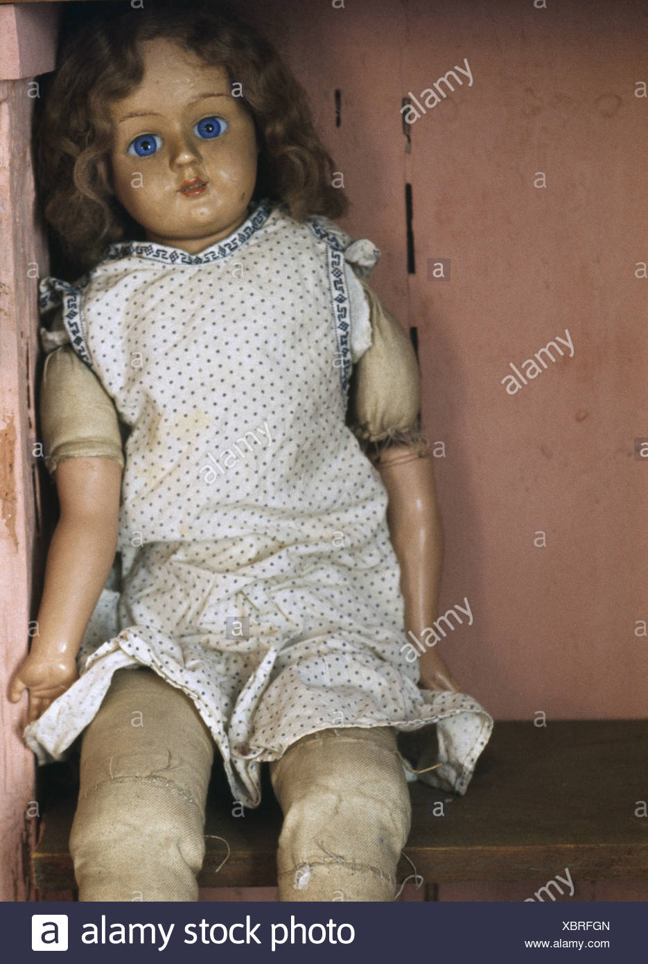 old doll sitting on a shelf stock photo 282644229 alamy