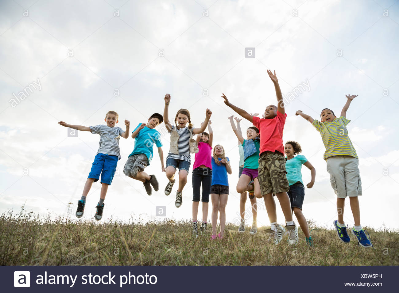79471275dbfd1 Group Of Five Happy Children Jumping Outdoors Photos