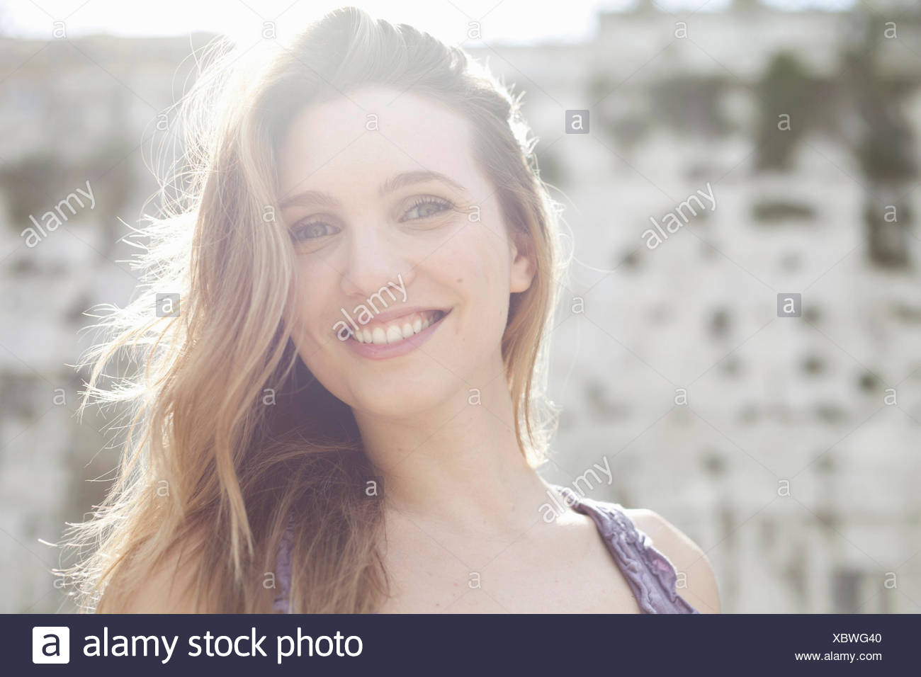 Portrait of a happy young woman - Stock Image