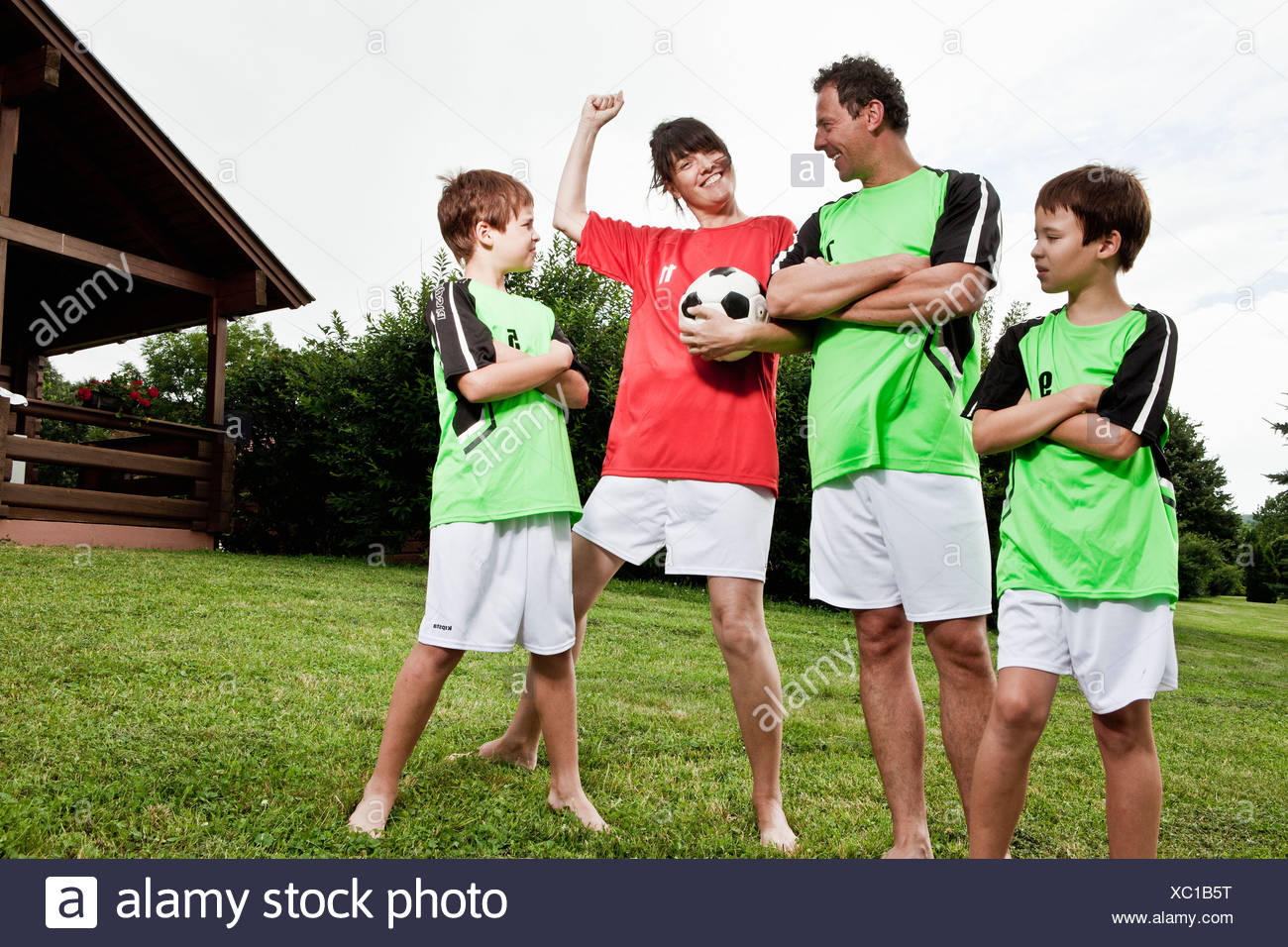Mother celebrating different team - Stock Image