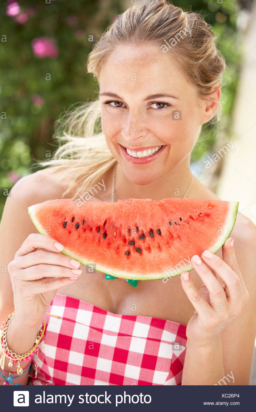 Couple Enjoying Slices Of Water Melon - Stock Image