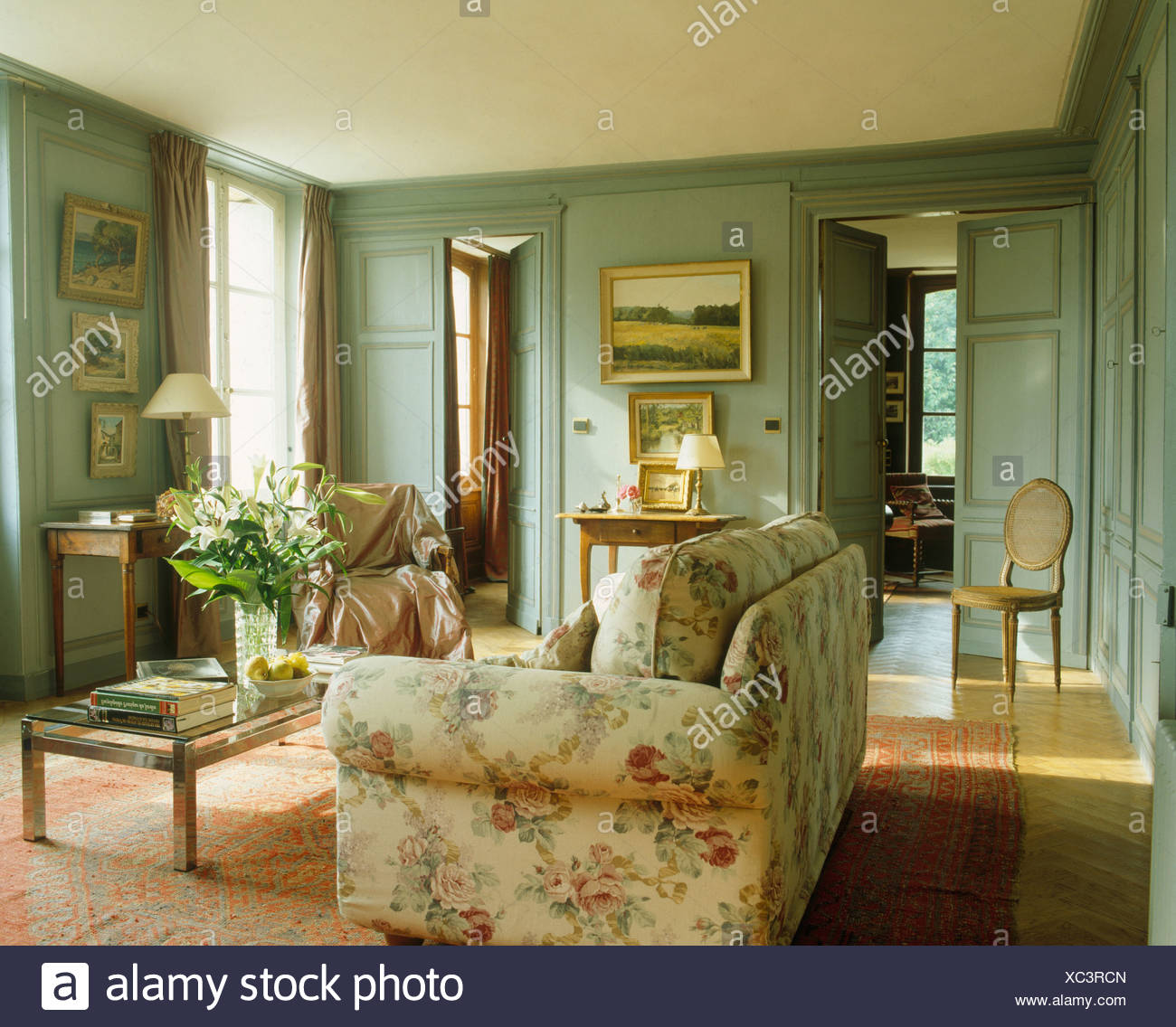 Floral Sofa In French Country Living Room With Gray Green Painted Walls