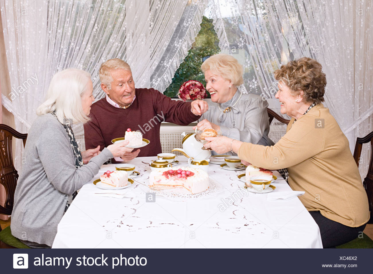 Friends having afternoon tea - Stock Image