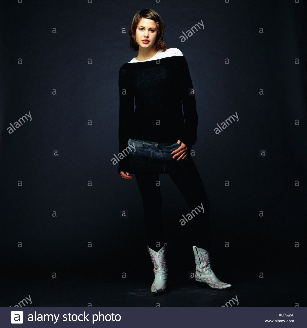 Young Woman Wearing Cowboy Boots Stock Photo 282903330 Alamy