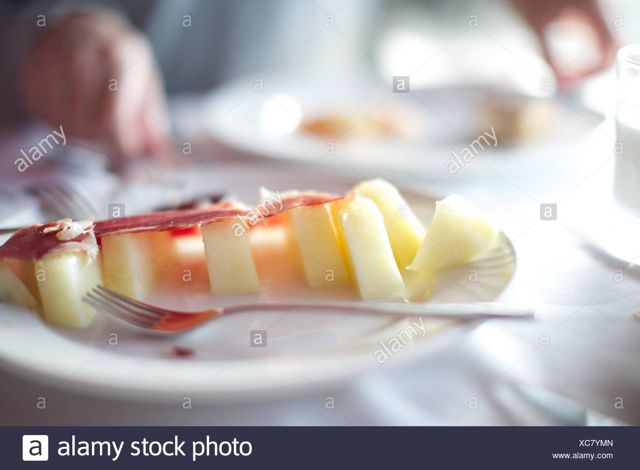 bacon with apple slice on plate. food, restaurant, fork, indulgence. - Stock Image