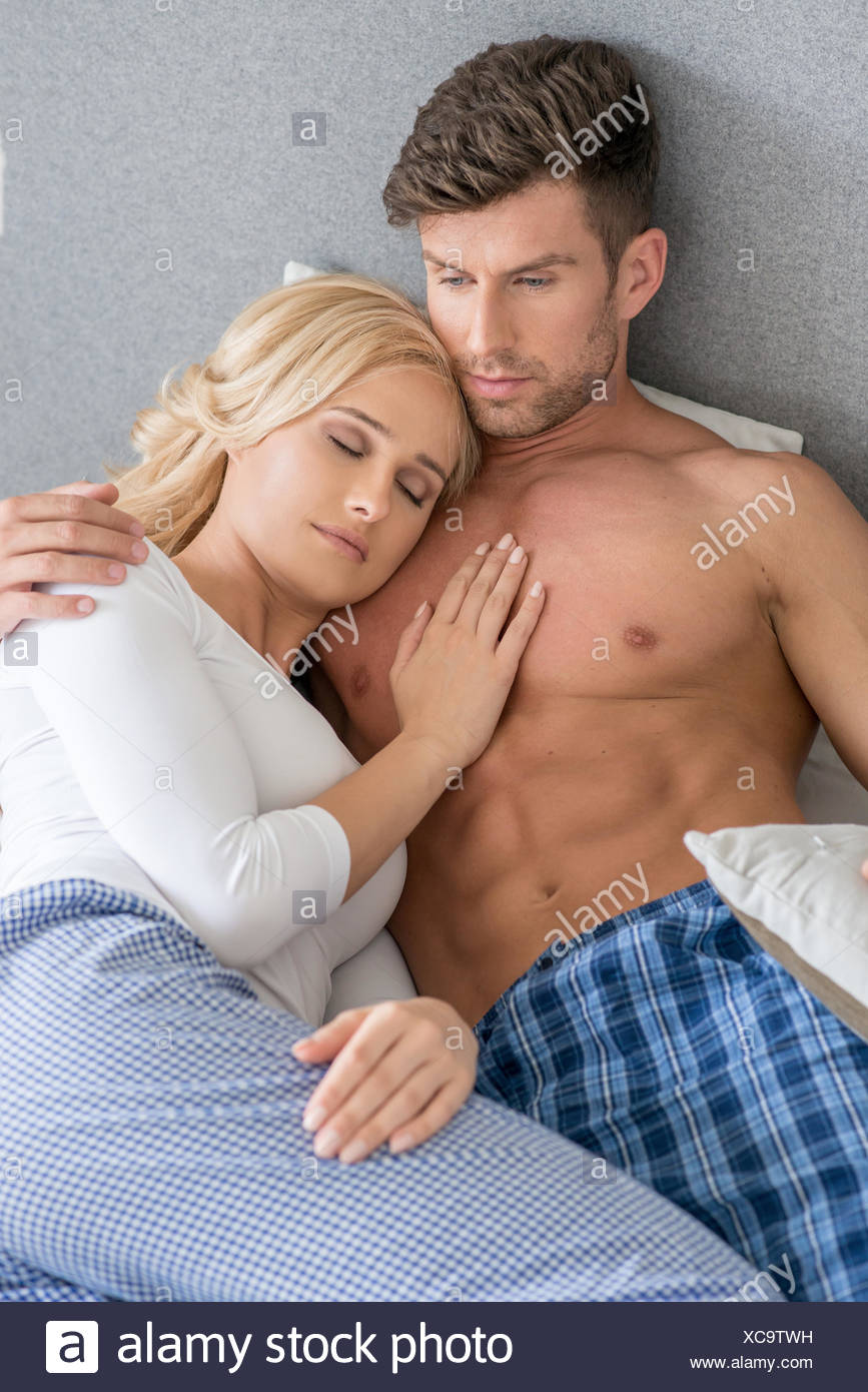 romantic lovers on bed