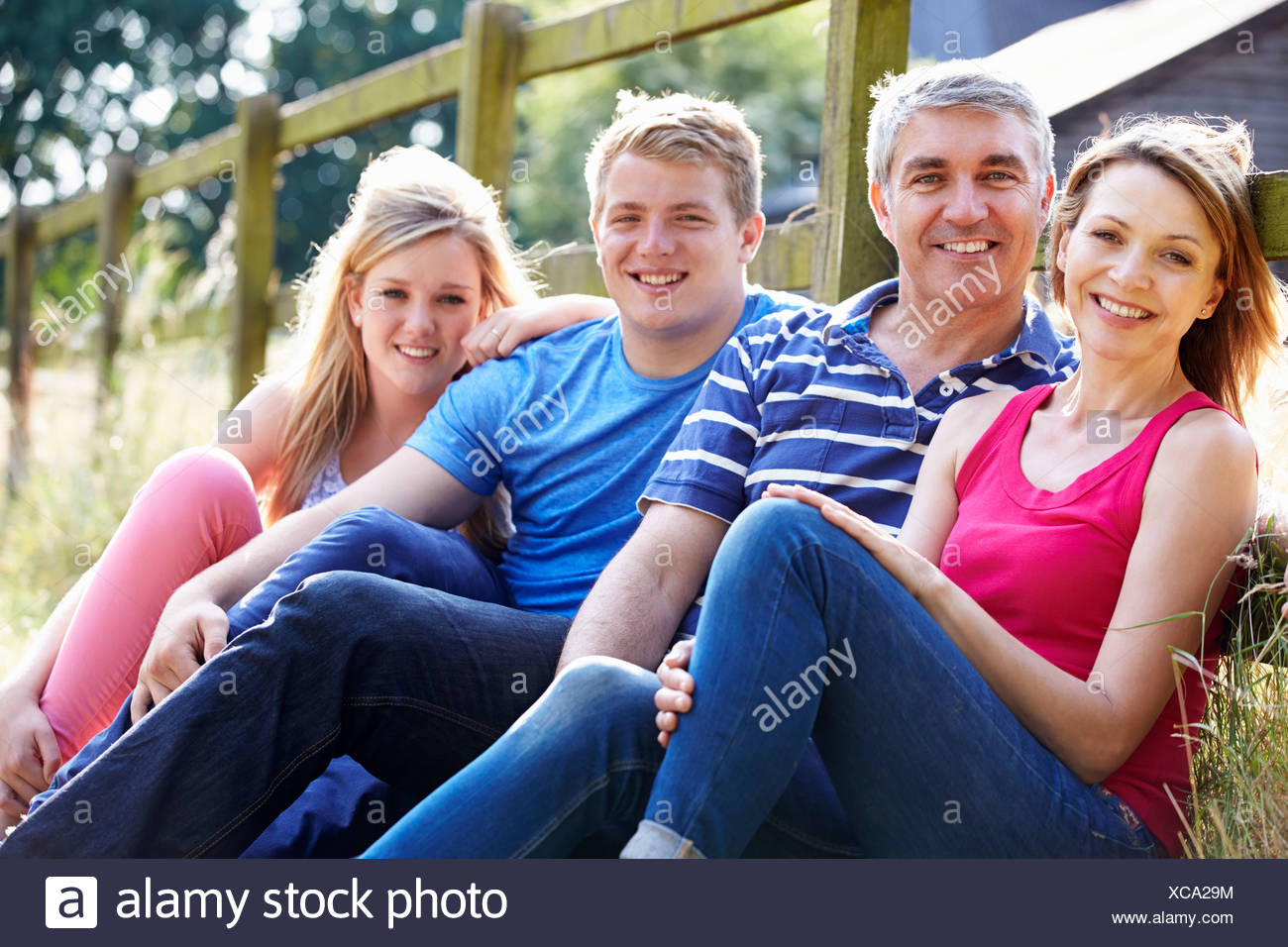Teenage Family Relaxing On Walk In Countryside - Stock Image