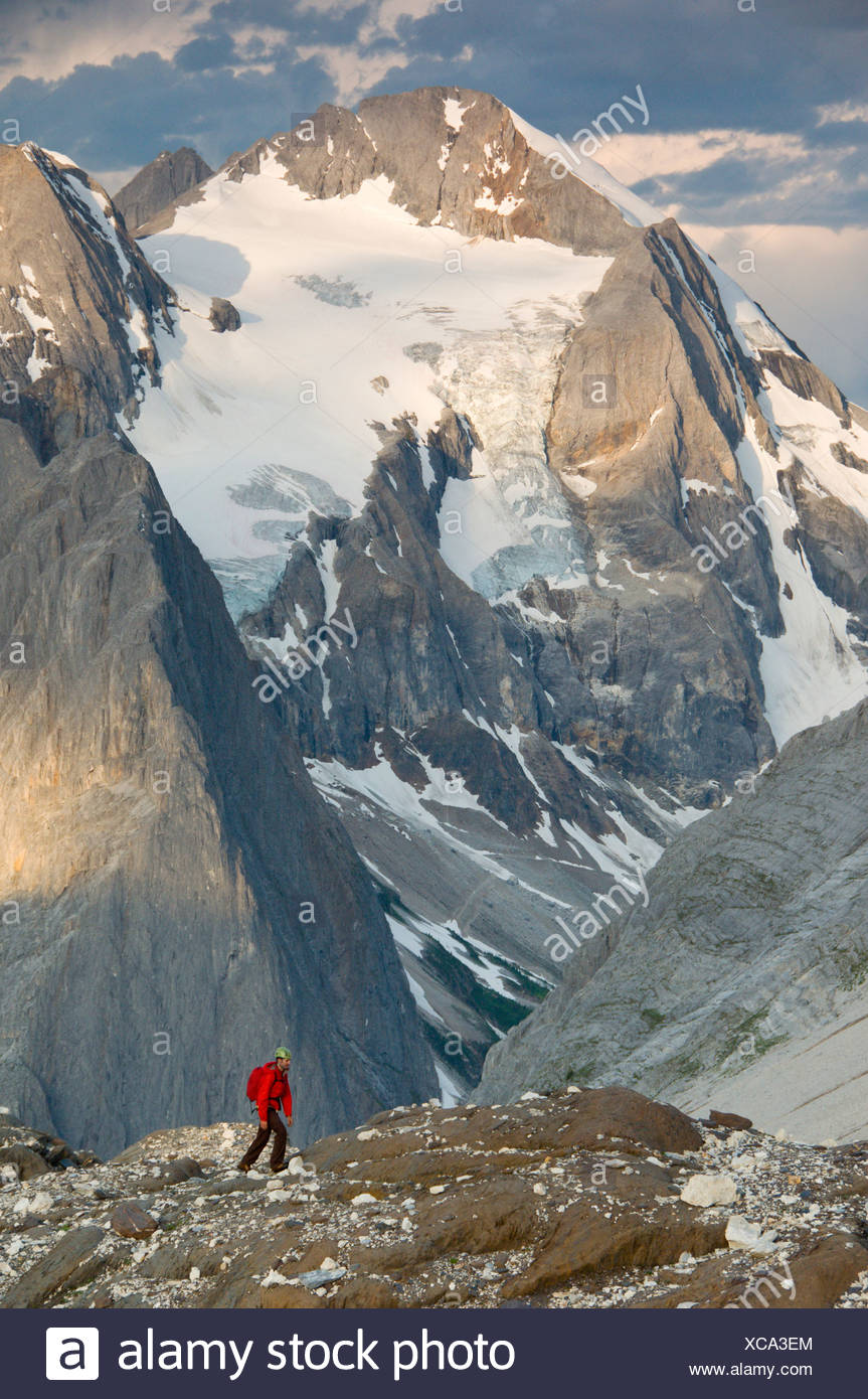 A mountaineer in front of the glaciers and limestone walls of Mount Albert, Selkirk Mountains, British Columbia, Canada - Stock Image