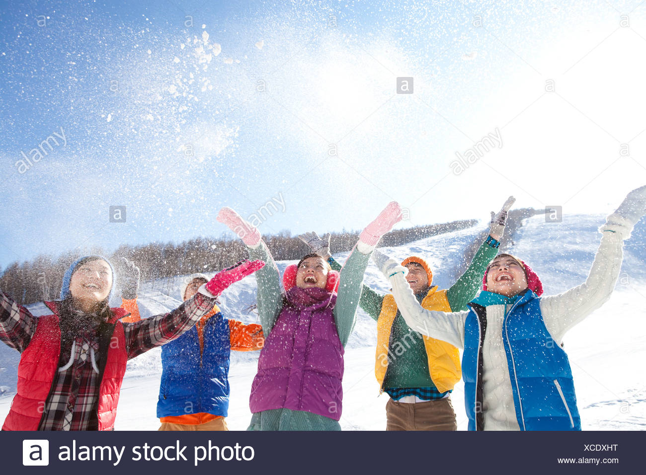 Happy young people in ski resort - Stock Image