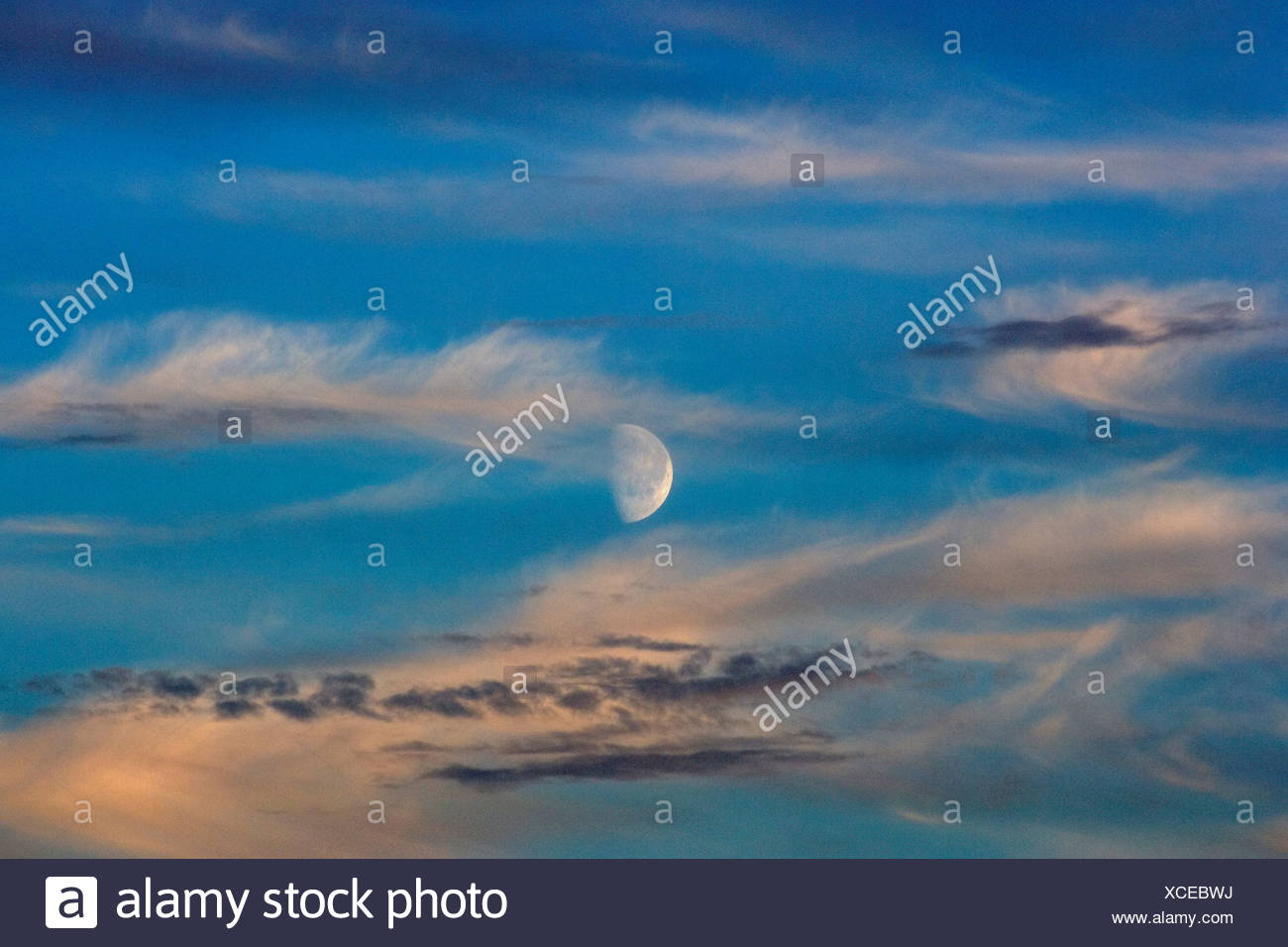 Half Moon Illuminated by the Midnight Sun - Stock Image