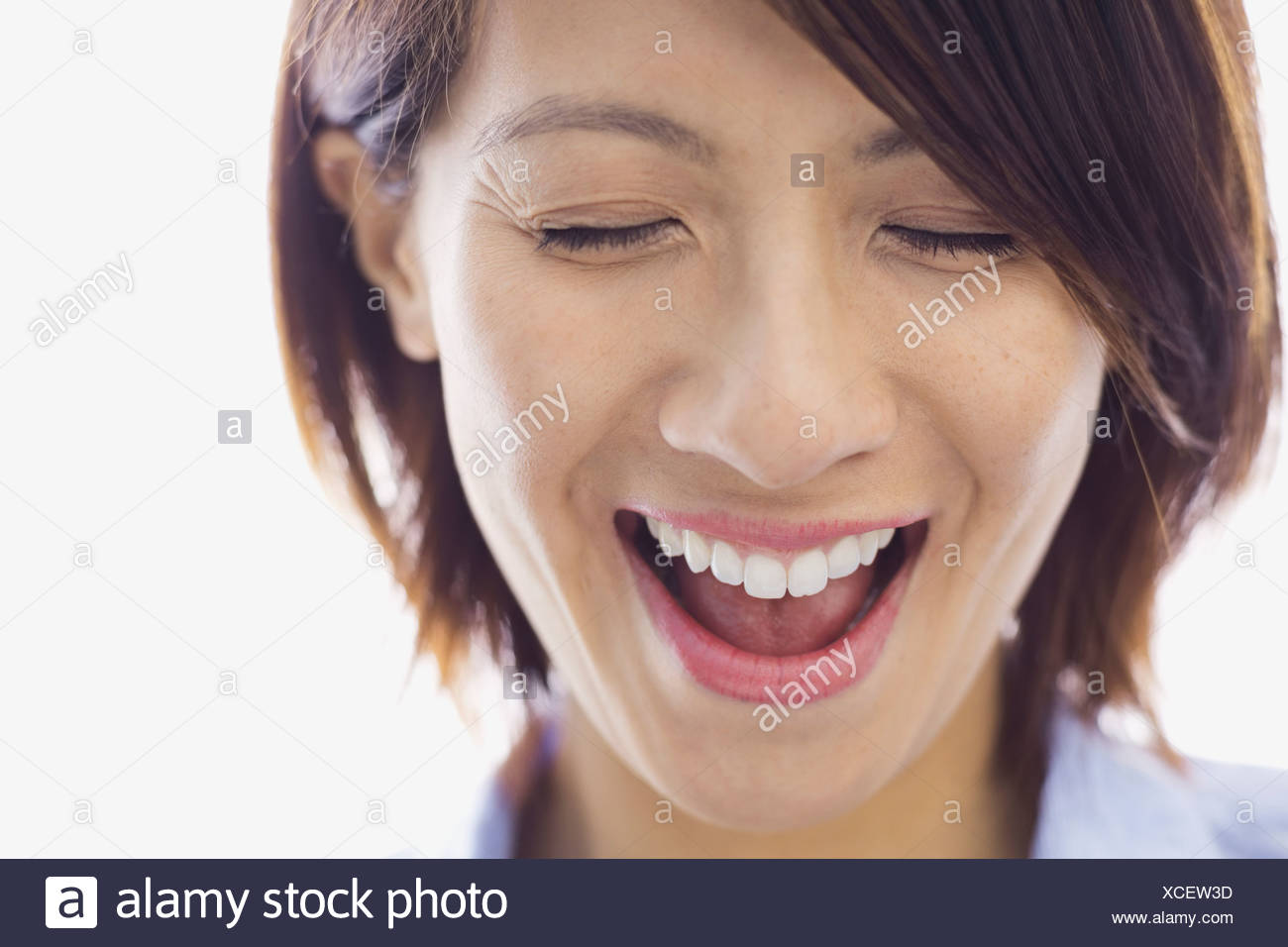 Close-up of woman laughing - Stock Image