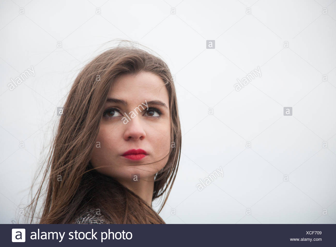 Portrait of a young woman with long hair - Stock Image