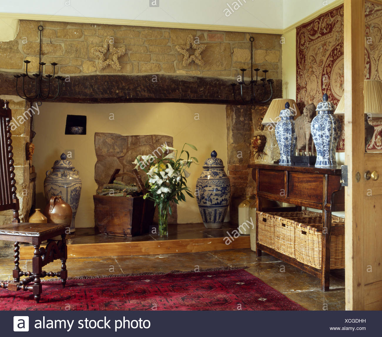 Inglenook Fireplace In Country Hall With Blue And White Vases On