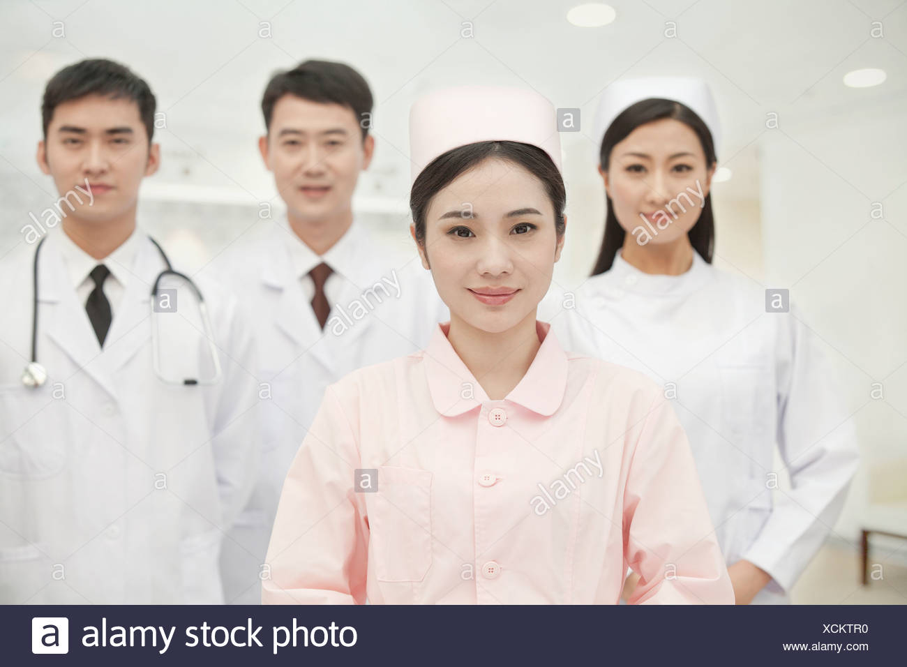 Portrait of Four Healthcare workers, China - Stock Image