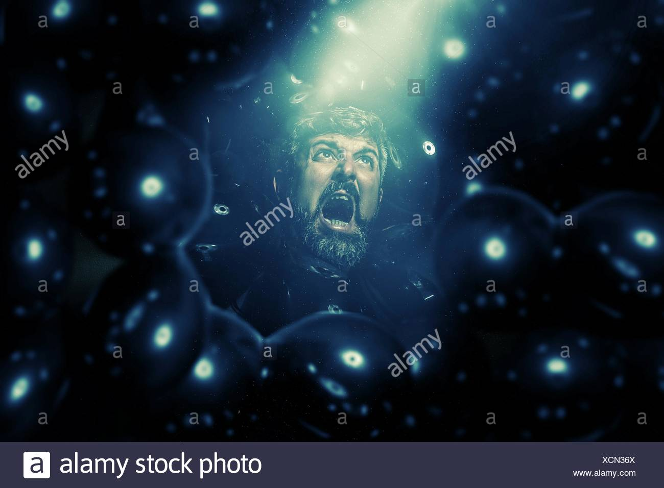 Bizarre Shot Of Man Screaming Out - Stock Image