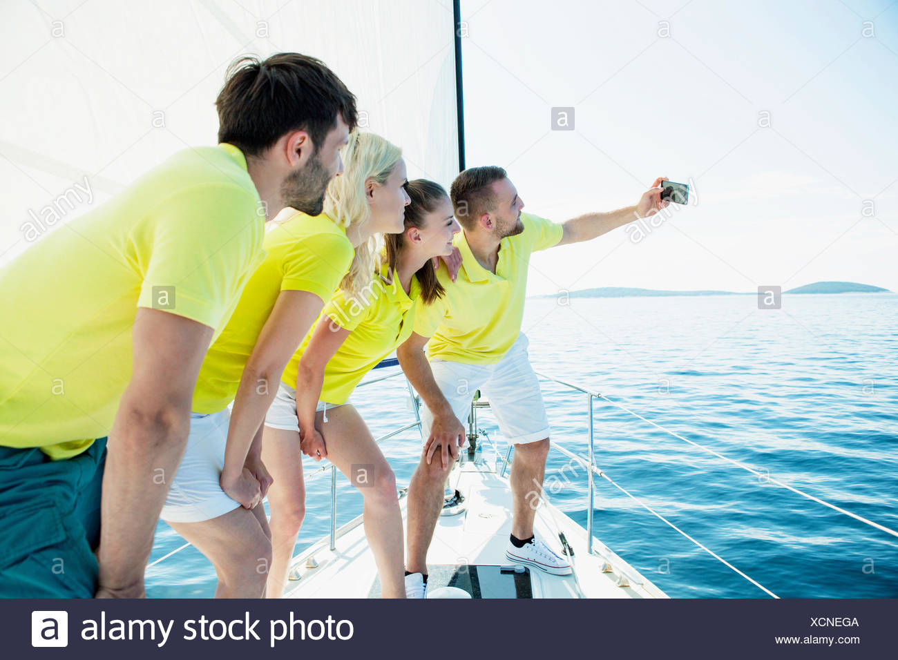 Group of friends taking pictures on sailboat, Adriatic Sea - Stock Image