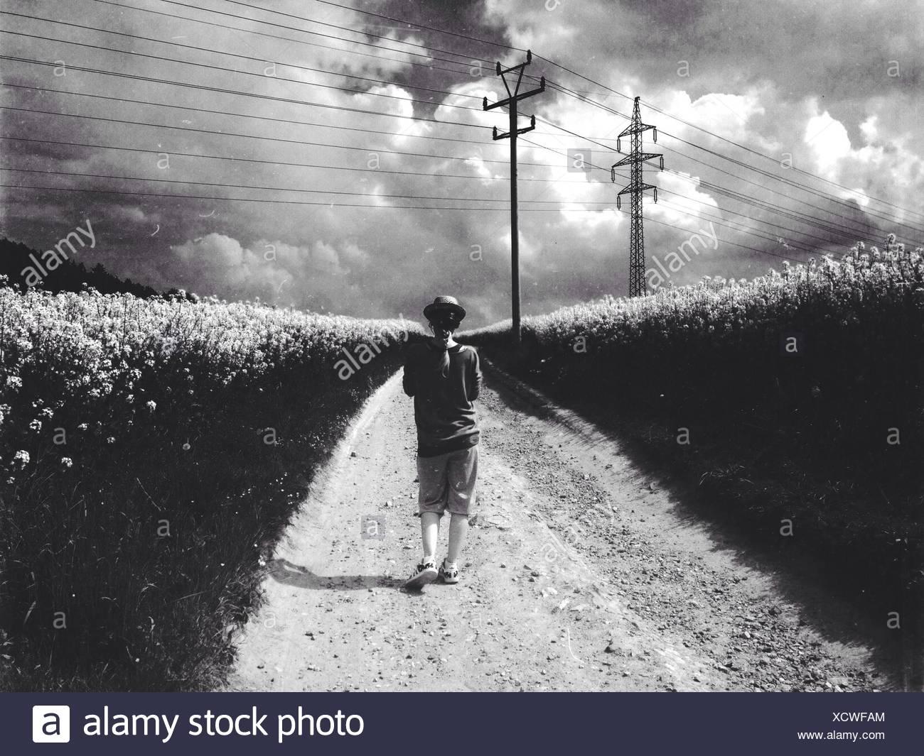 Woman Walking Through Field - Stock Image
