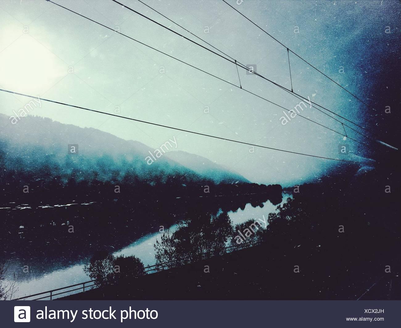Power Line Along River - Stock Image