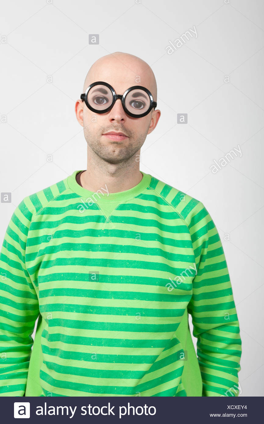Man wearing crazy glasses - Stock Image