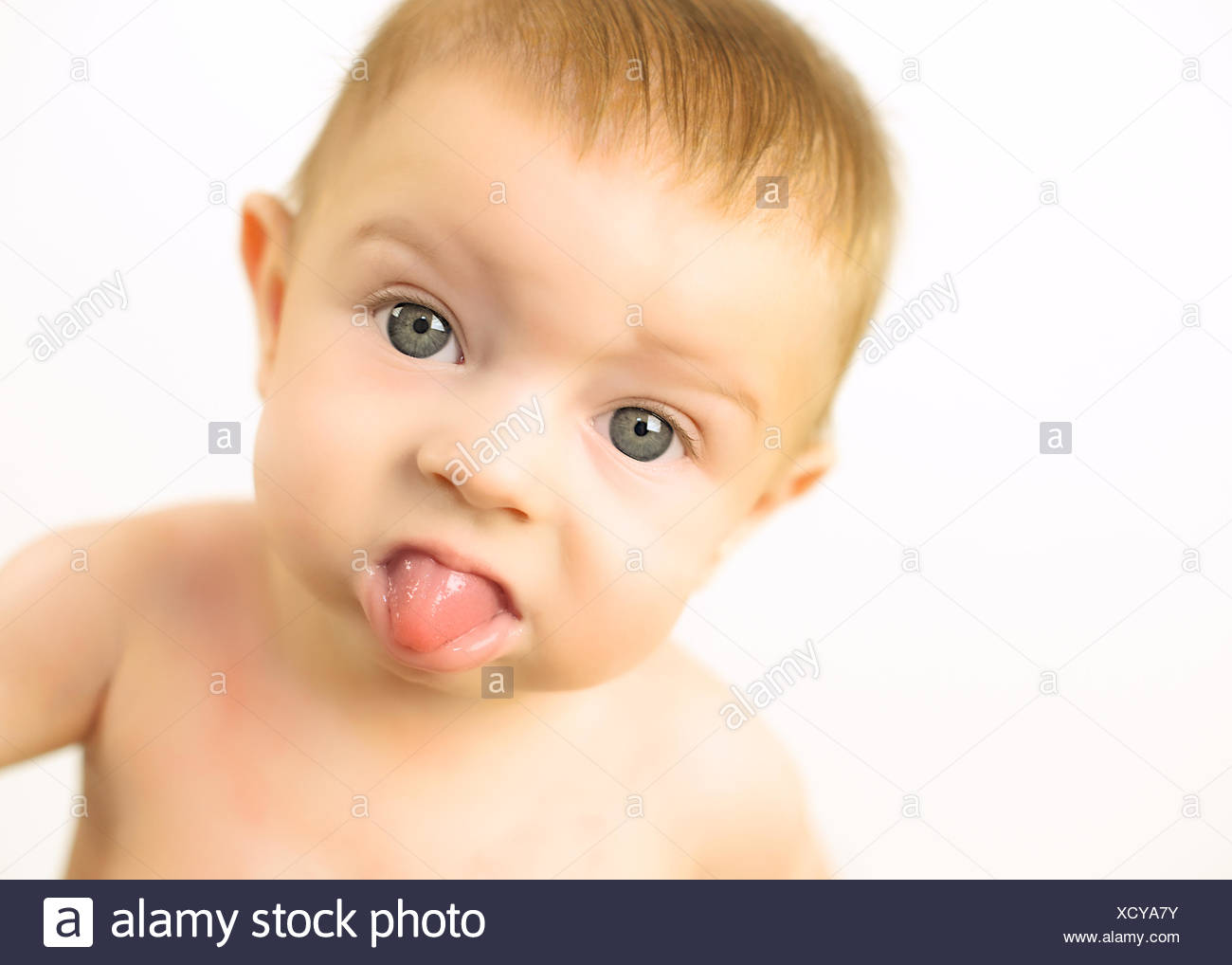 Cheeky baby girl (6-11 months) - Stock Image