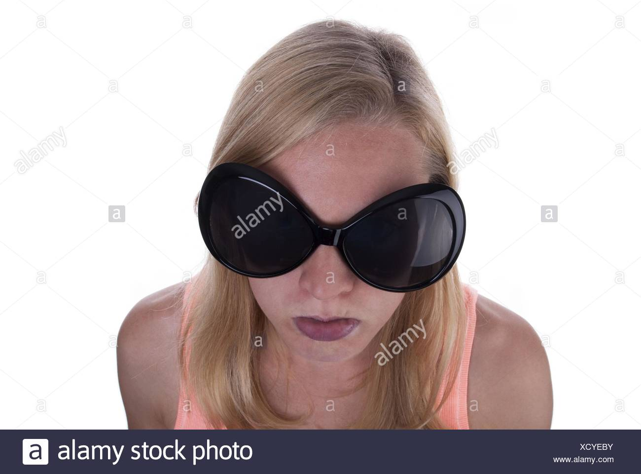 57648b3e8a1 A Young Blond Teen With Huge Sunglasses Sulking