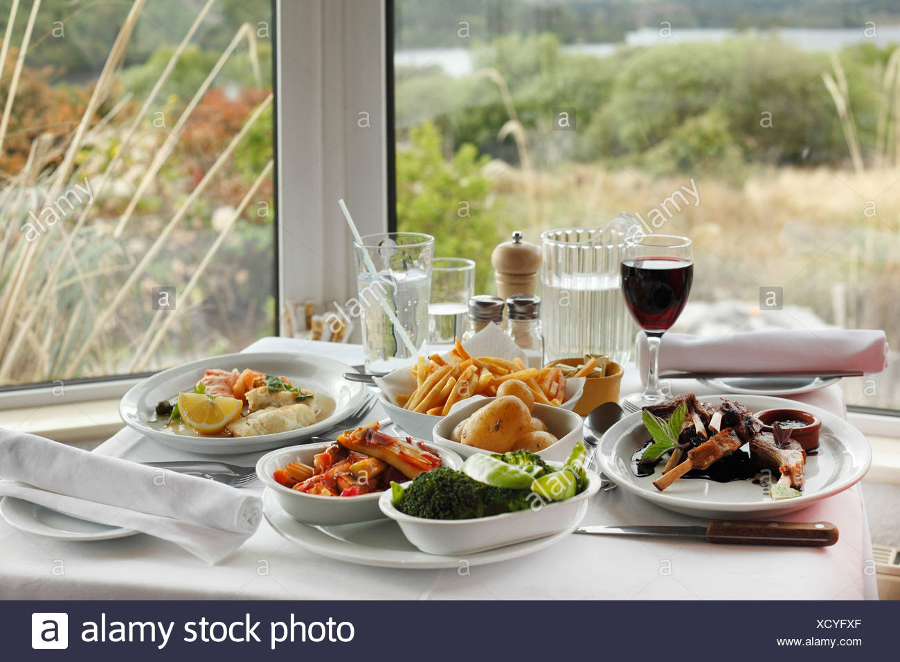 Dinner with lamb chops and red wine, Josie's Lakeview House, Beara Peninsula, County Kerry, Ireland, British Isles, Europe - Stock Image