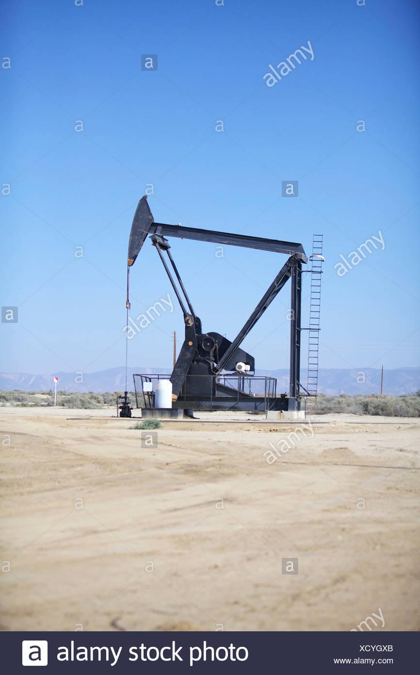 Derricks in oil well, California - Stock Image