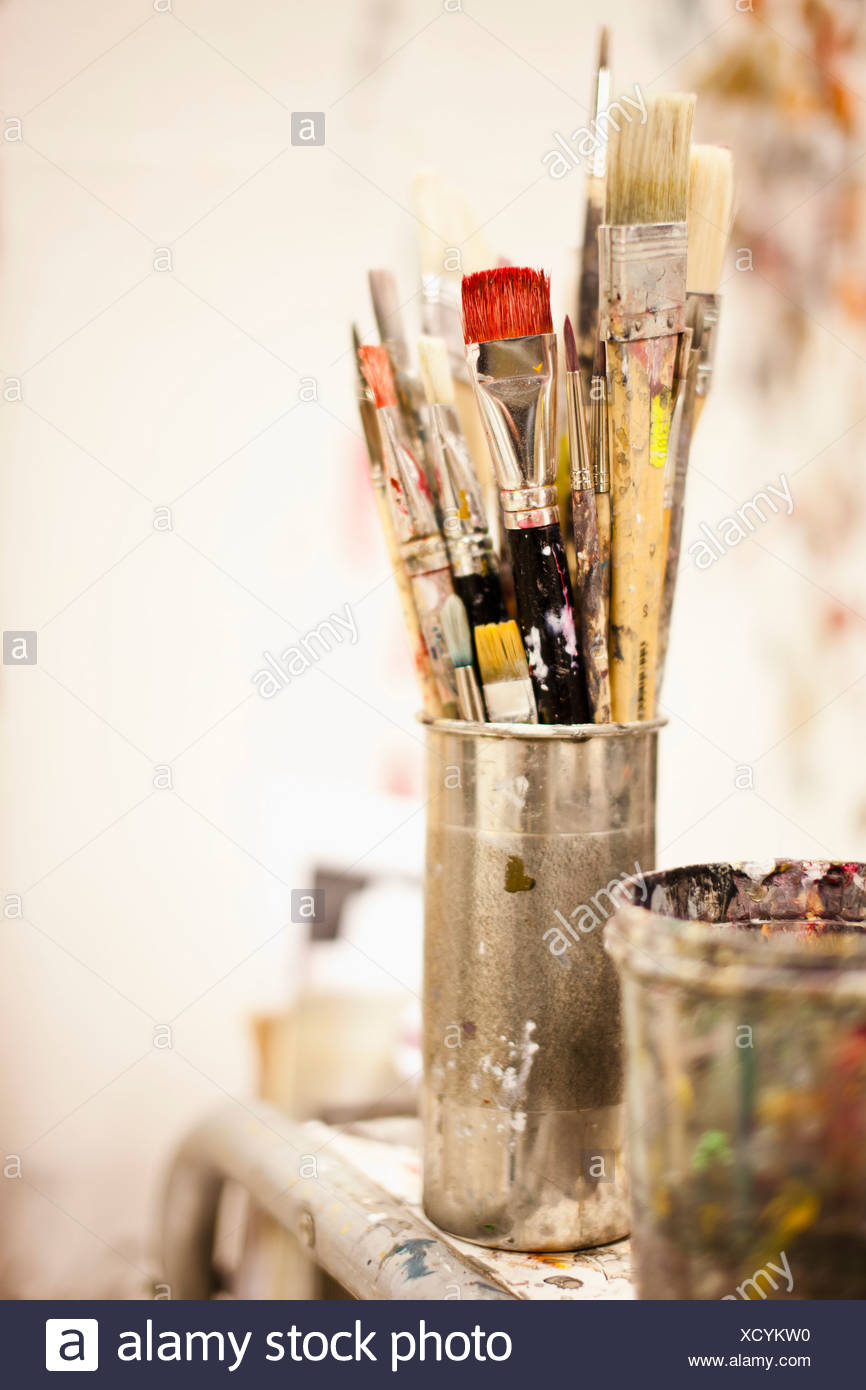 Paintbrushes in artist´s studio - Stock Image