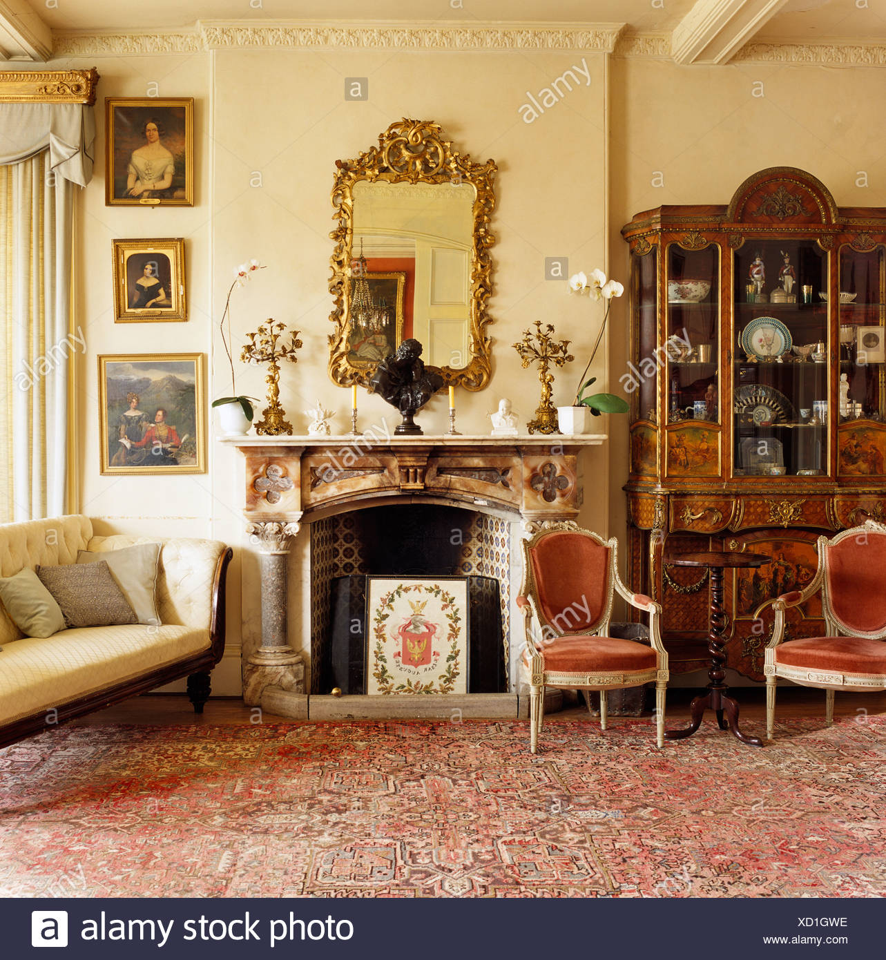 Incroyable Antique Cabinet And French Style Chairs In Drawing Room With Large Gilt  Mirror Above Ornate Fireplace
