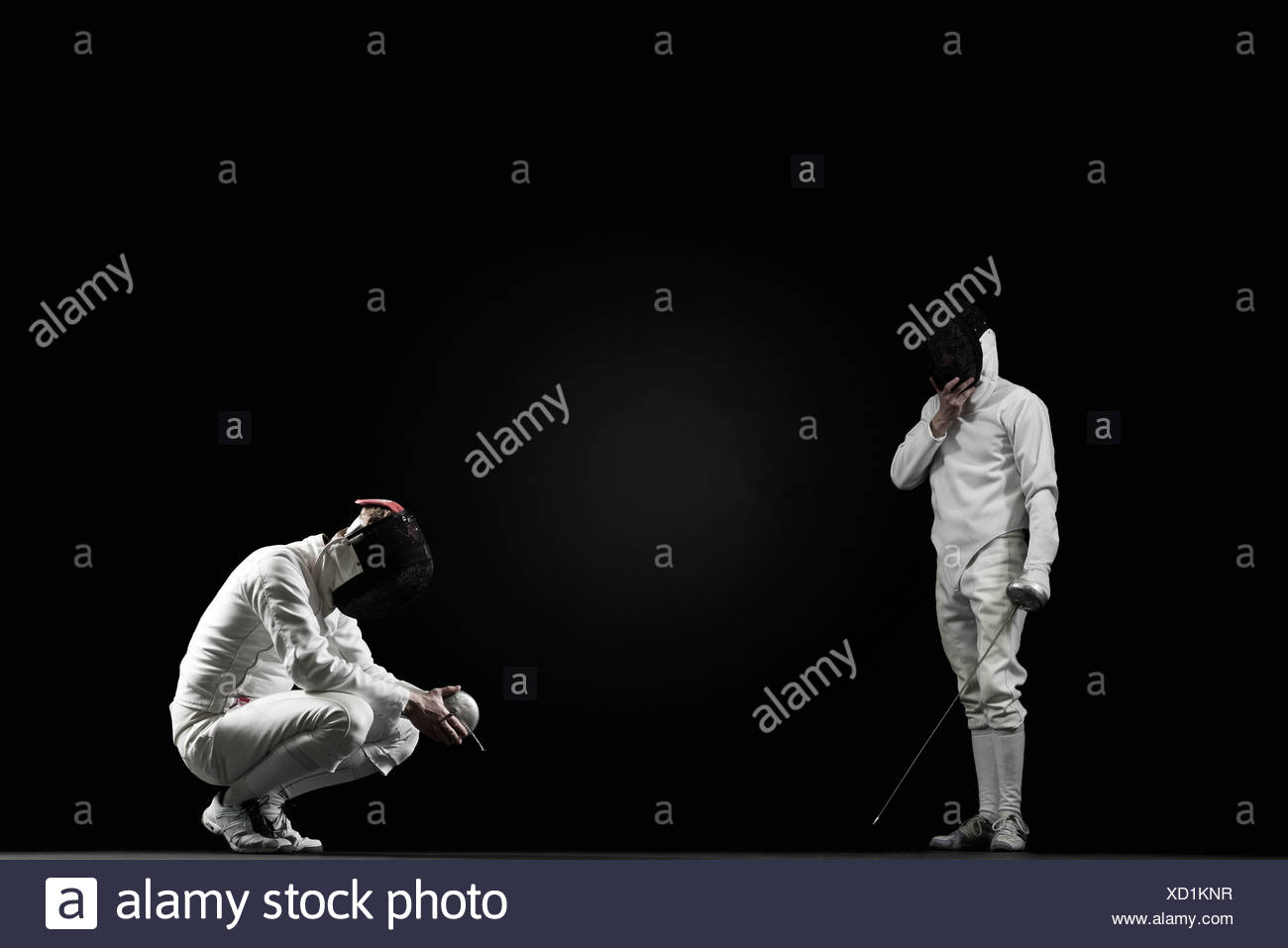 Winning fencer and defeated fencer - Stock Image