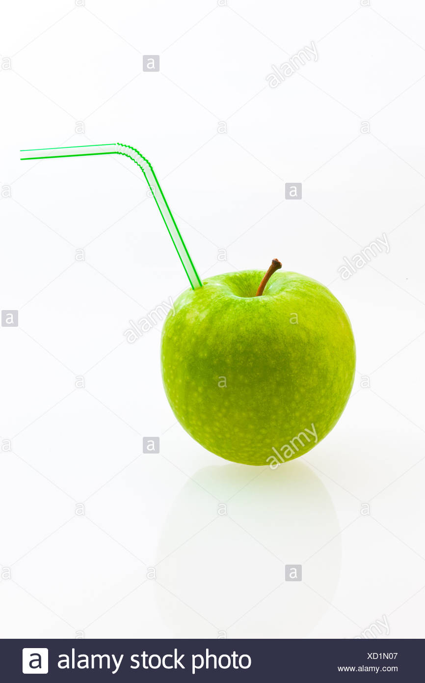 Apple with a straw in it like a soft drink - Stock Image