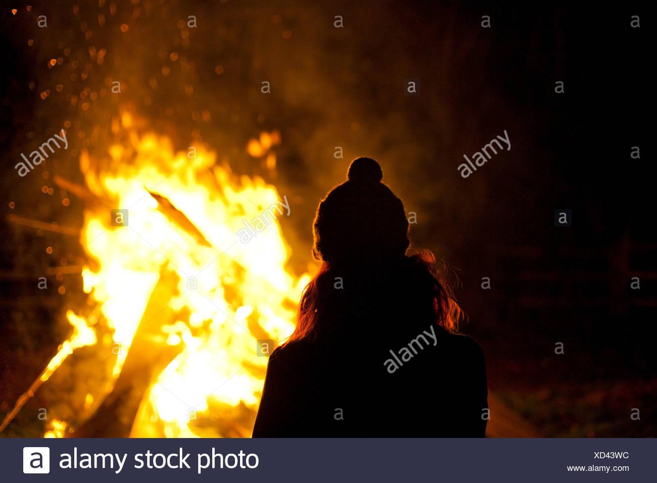 Woman on bonfire night - Stock Image