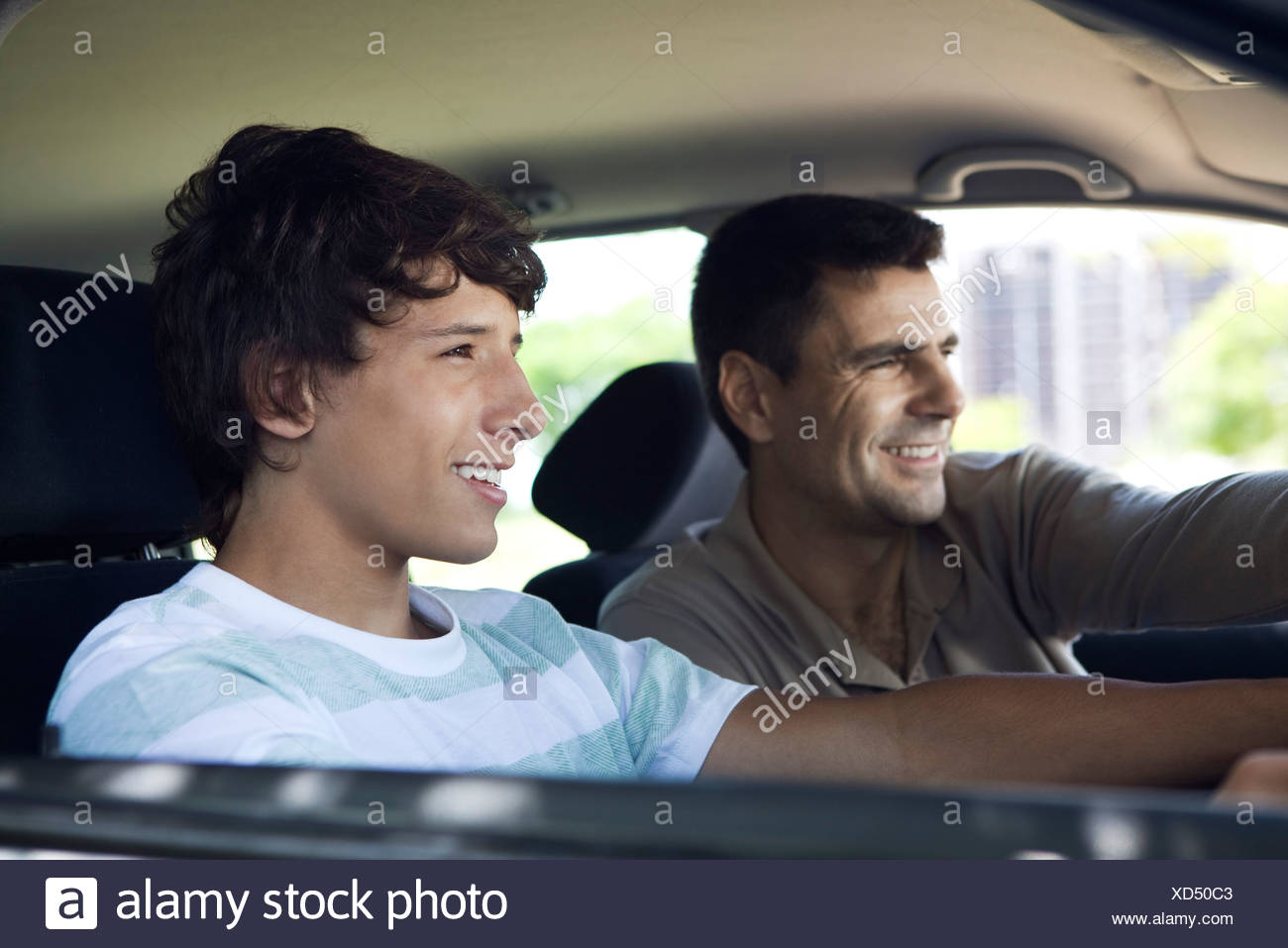 Father teaching son to drive - Stock Image