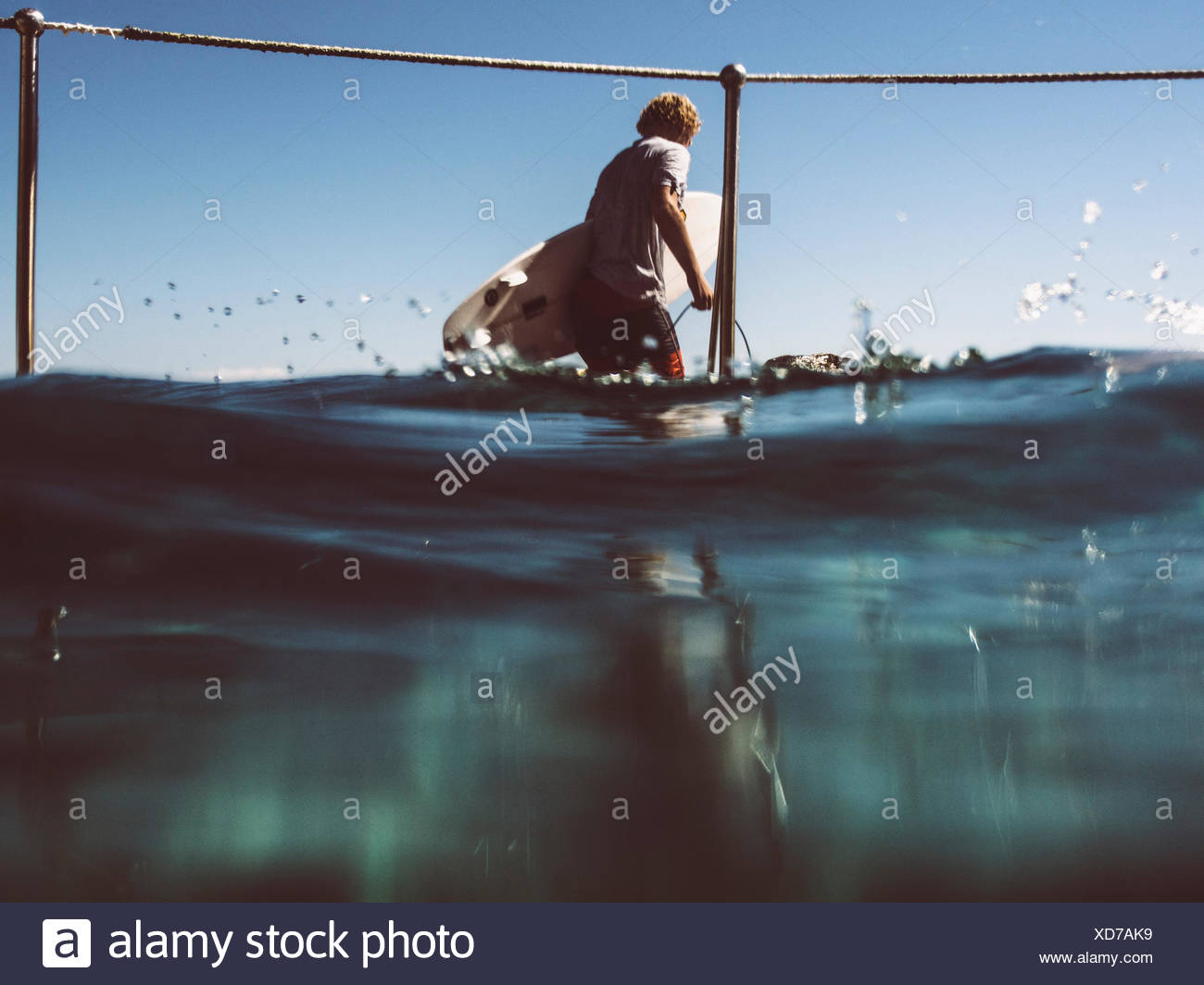 Man With Surfboard - Stock Image